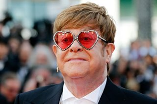 Elton John touches down in Cannes for sparkling 'Rocketman' premiere