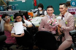 We do: Taiwan's gay newlyweds urge Asia to follow their lead
