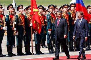 Xi Jinping arrives in Russia