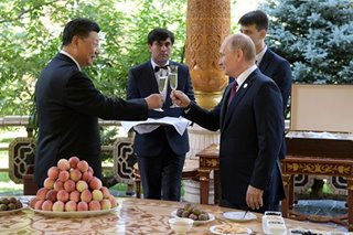 Xi gets birthday ice cream from 'best friend' Putin