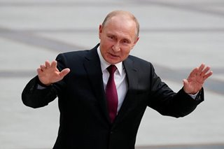 As ratings drop, Putin defends record, says better life awaits Russians