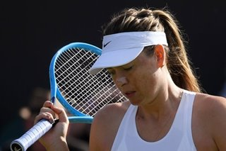 Tennis: Sharapova quits Wimbledon in pain but vows to fight on