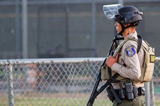 California police hunt for gunman's accomplice in festival shooting