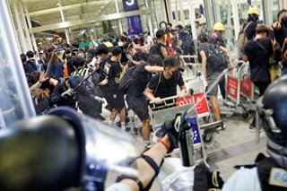 Hong Kong airport resumes flights after clashes, mass protests