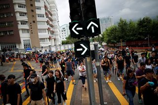 More mass protests planned in Hong Kong after peaceful weekend of rallies