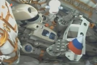 Russian humanoid robot boards space station after delay