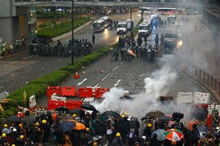 Hong Kong police turn water cannon on protesters, fire tear gas