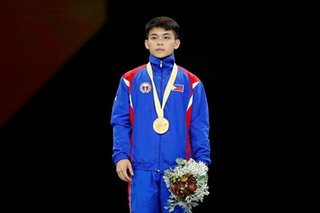 Gymnastics phenom Carlos Yulo wins historic gold on world stage