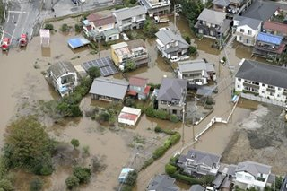 Rescuers hunt for missing as landslides, floods kill 10 in Japan
