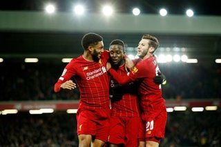 Football: Liverpool reach League Cup quarters after thriller against Arsenal