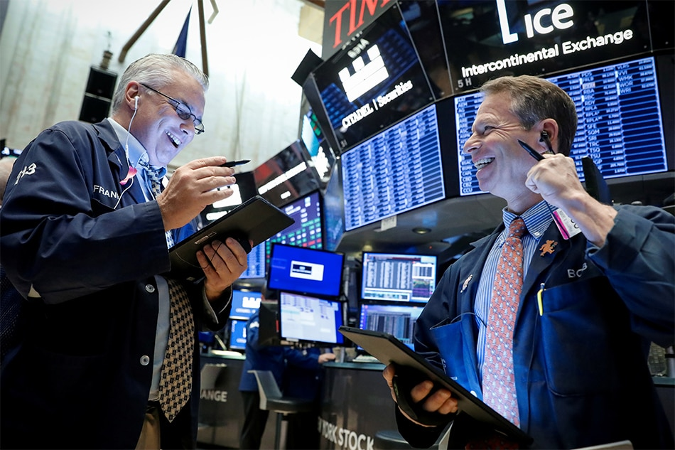 Dow, Nasdaq hit record highs for second consecutive day