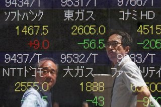 Asian stocks see brighter world as trade, UK clouds lift