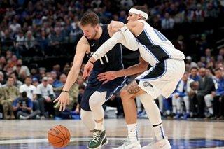 NBA: Mavericks hang on to trim Magic
