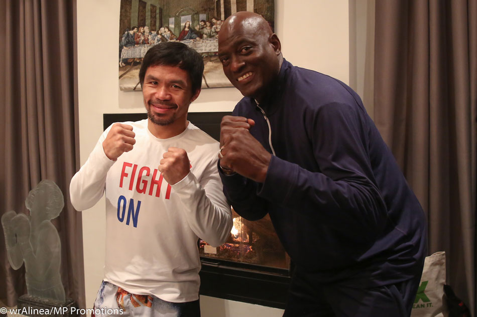 Pacquiao, Mayweather cross paths at National Basketball Association  game