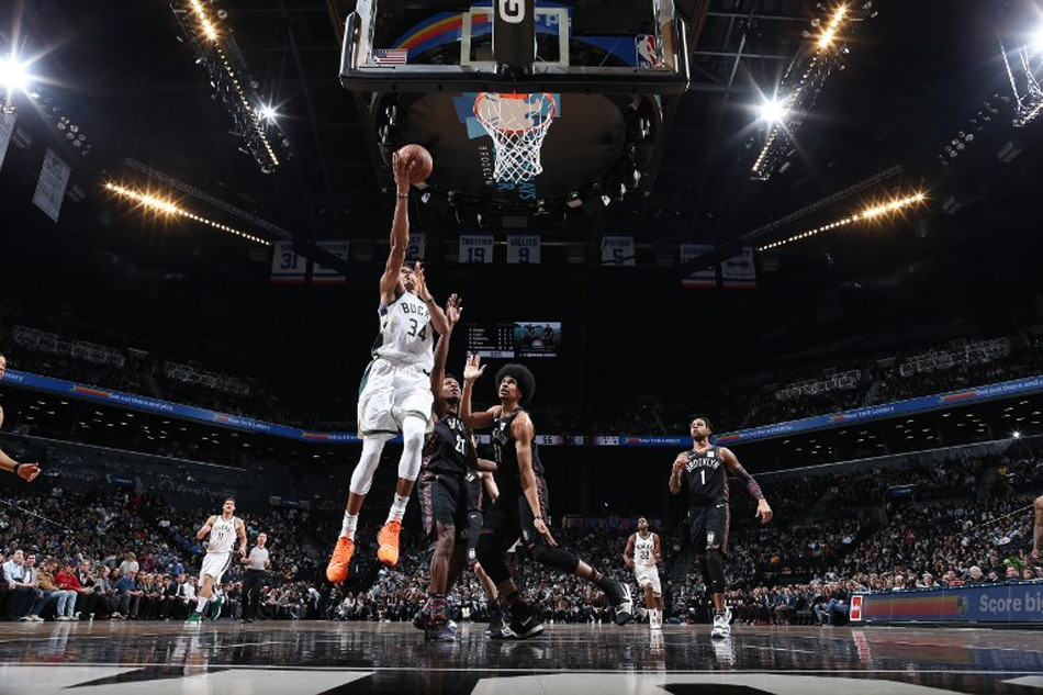 Giannis Antetokounmpo posts 30 points, 15 boards, 9 dimes in Bucks' victory
