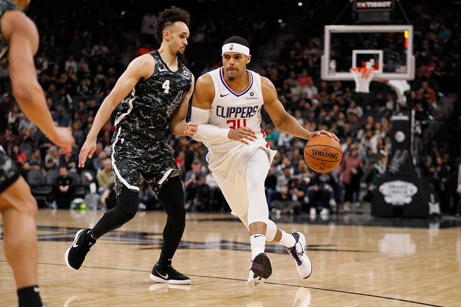 Sixers land forward Harris from Clippers in six-player trade