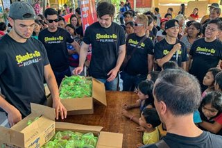 Paras brothers Kobe, Andre visit quake victims in Davao
