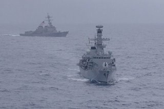 China says US aims to 'stir up trouble' with naval sail-by