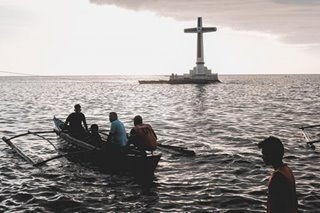 Tourists check out Camiguin's Sunken Cemetery