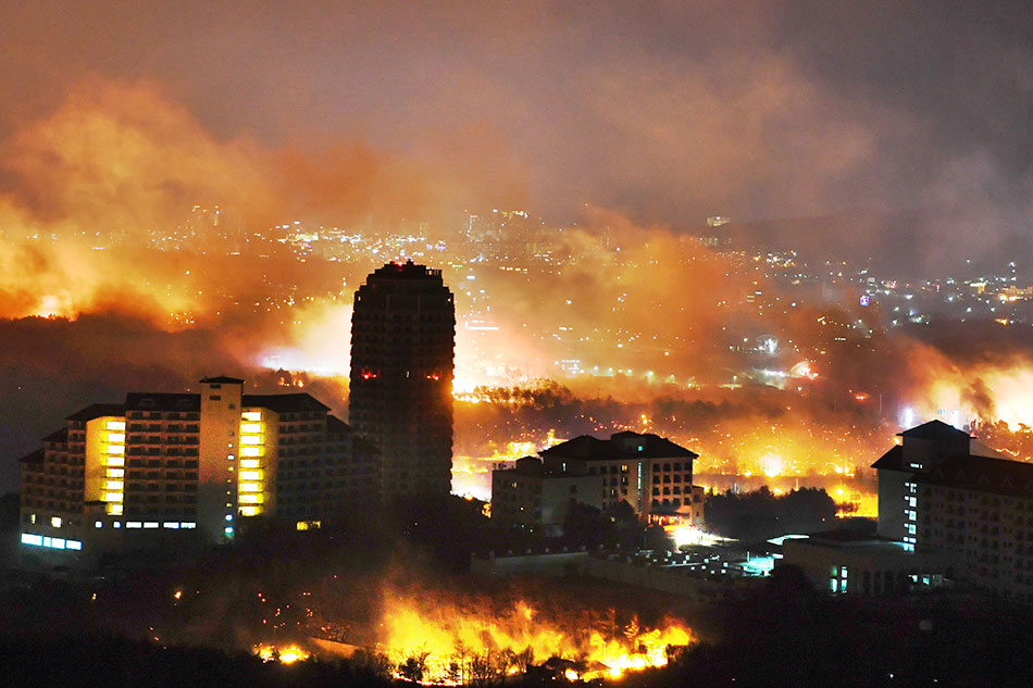 Thousands flee their homes as wildfires rip through South Korea