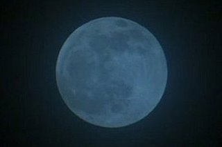 Seasonal blue moon rises Sunday