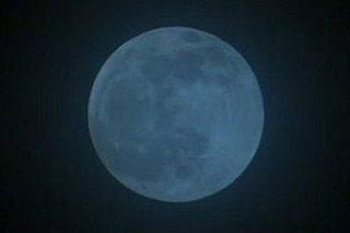 Seasonal blue moon rises Sunday