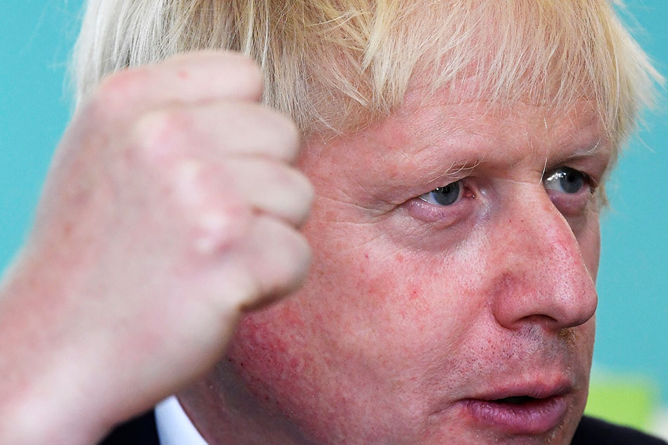 Boris Johnson heckled during speech: 'Get back to parliament'