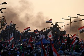 Iraqis pour into streets for biggest protest day since Saddam Hussein