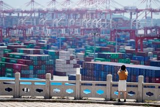 China exports fall in November, imports recover