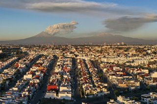 Mexico's Popocatepetl volcano belches fiery cloud