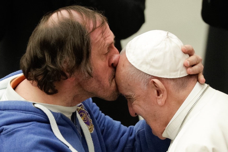 Kissing the Pope