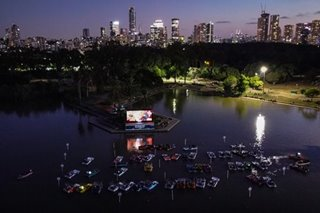 A movie night, on boats, under the stars