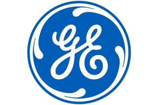 General Electric reports loss amid weakness in aviation
