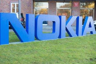 Nokia flips back into profit