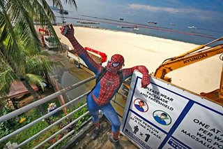 'Spiderman' visits Manila Bay's white sand beach