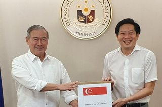 PH receives coronavirus test kits, PCR machine donated by Singapore