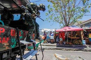 PNP-SAF enforces lockdown rules in Libertad market
