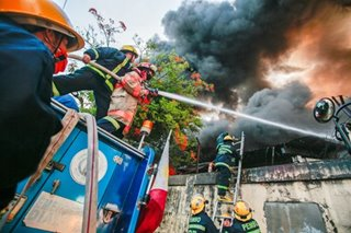 Fire hits Bicutan warehouses