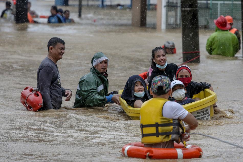 Children are rescued by community rescue volunteers in Barangka, Marikina after Typhoon Ulysses swept thru Luzon on Thursday, November 12, 2020. Fernando G. Sepe Jr., ABS-CBN News