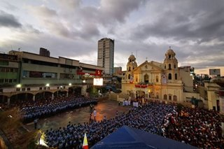 LOOK: Layers of cops block devotees awaiting Nazarene's return to Quiapo church