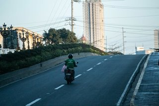 Frontliners on 2 wheels keep Philippine economy moving during COVID-19 lockdown