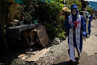 In a Philippine lockdown, priests bring church to the community