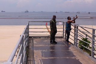 A glimpse of Manila Bay's controversial 'white sand'