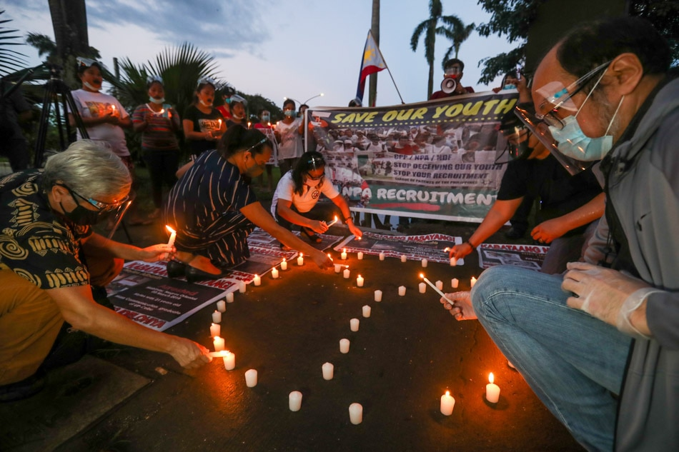 Anti-communist groups hold candle lighting protest