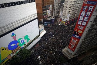 Thousands march in Hong Kong on New Year's Day, pledge to 'keep fighting'