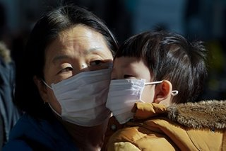 South Korea's Moon urges calm amid protests over coronavirus quarantine sites