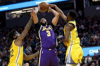 NBA: Lakers fend off Warriors' comeback bid