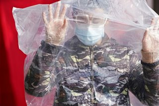 China virus deaths rise past 900, overtaking SARS toll