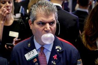 World stocks slide on Apple's virus warning, euro near 3-year low