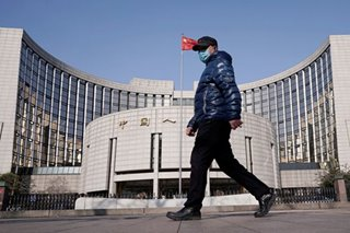 China cuts loan rate as it battles coronavirus impact